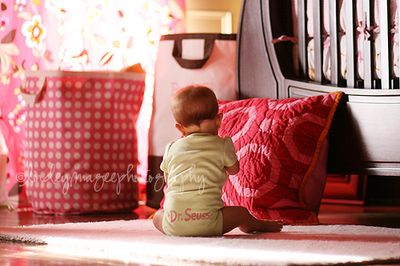 pailyn playing in her nursery at 6 months